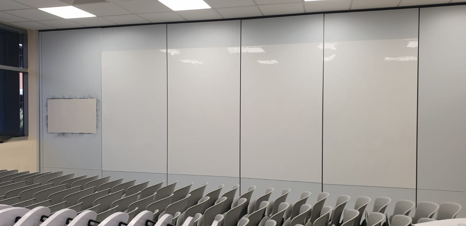 Magnetic whiteboard on hall partition walls